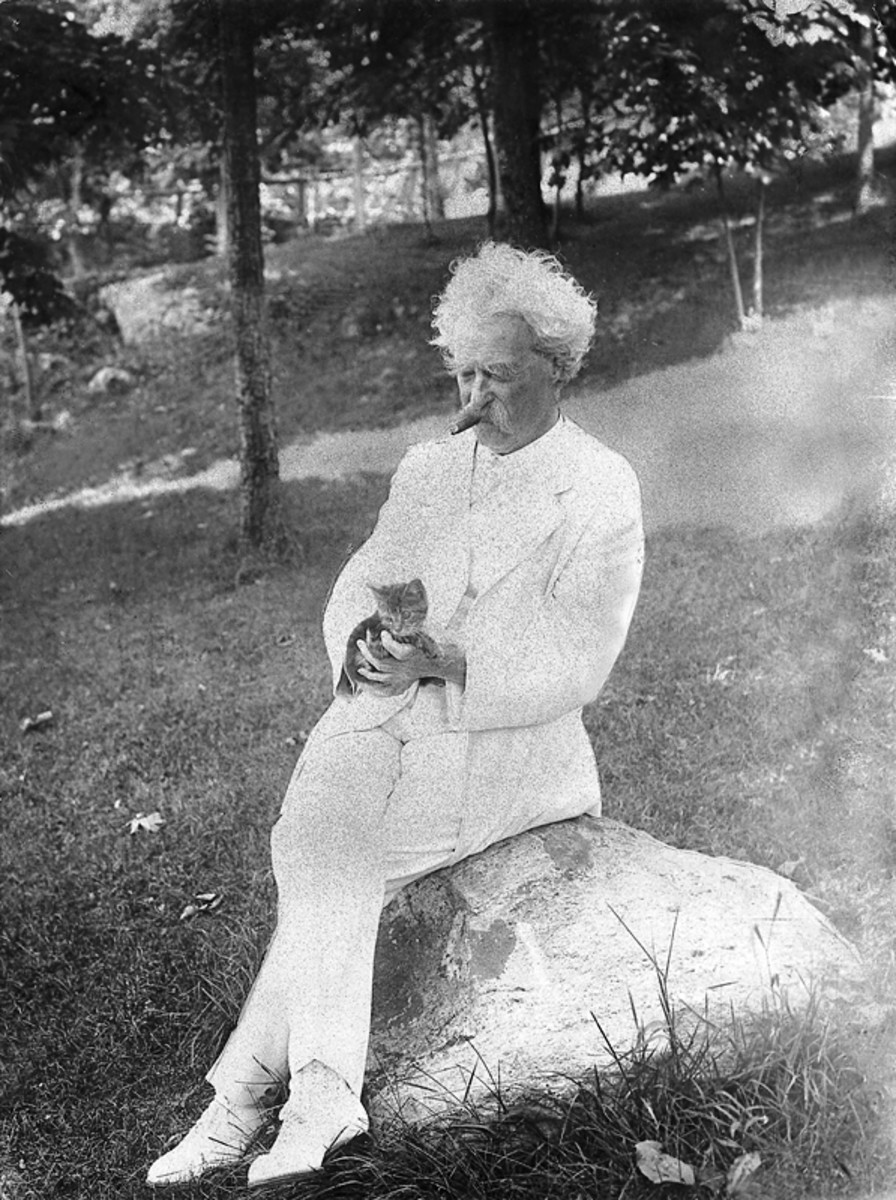 "Mark Twain strokes a kitten (1907).  Cats were plentiful in Twain's life, and he understood them as creatures that could never be dominated.  He wrote, ""There's always somebody a king has to obey ... but it ain't so with a cat."""