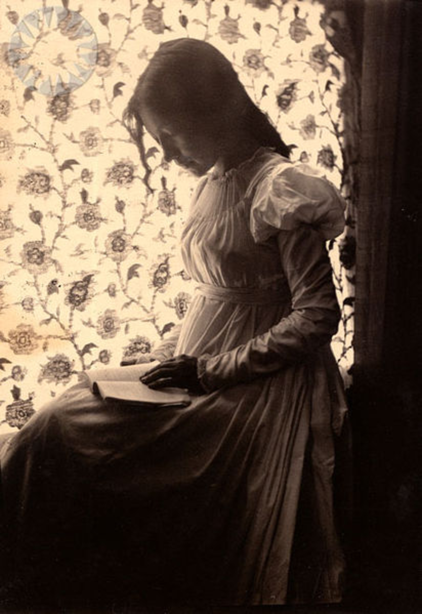 """Zitkala-Sa"" reading by windowlight; ""Zitkala-Sa"" in pencil on verso ..Credit: Gertrude Kasebier (Smithsonian Institution)"