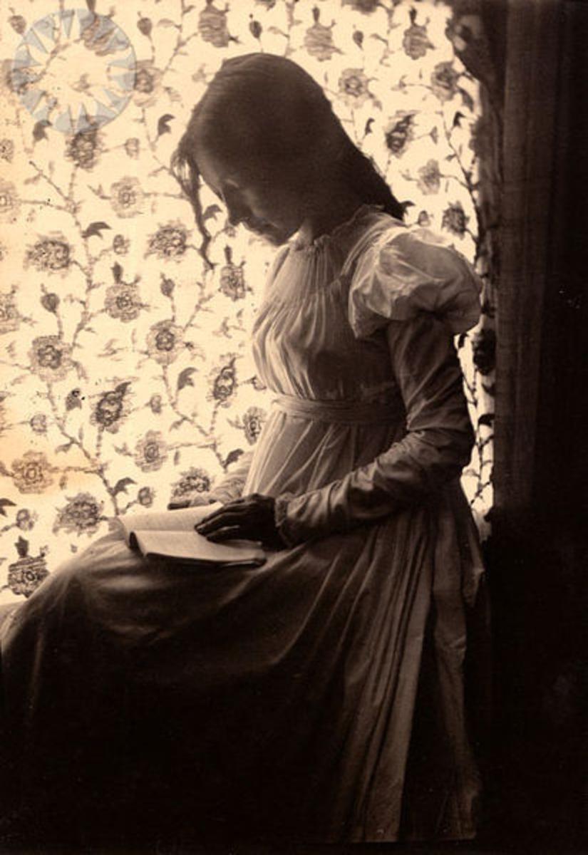 """Zitkala-Sa"" reading by windowlight; ""Zitkala-Sa"" in pencil on verso ..Credit: Gertrude Kasebier (Smithsonian Institution)"
