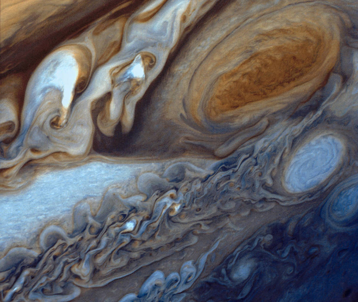 Early in 1979, NASA's Voyager 1 spacecraft zoomed toward Jupiter, capturing hundreds of images during its approach, including this close-up of swirling clouds around Jupiter's Great Red Spot.