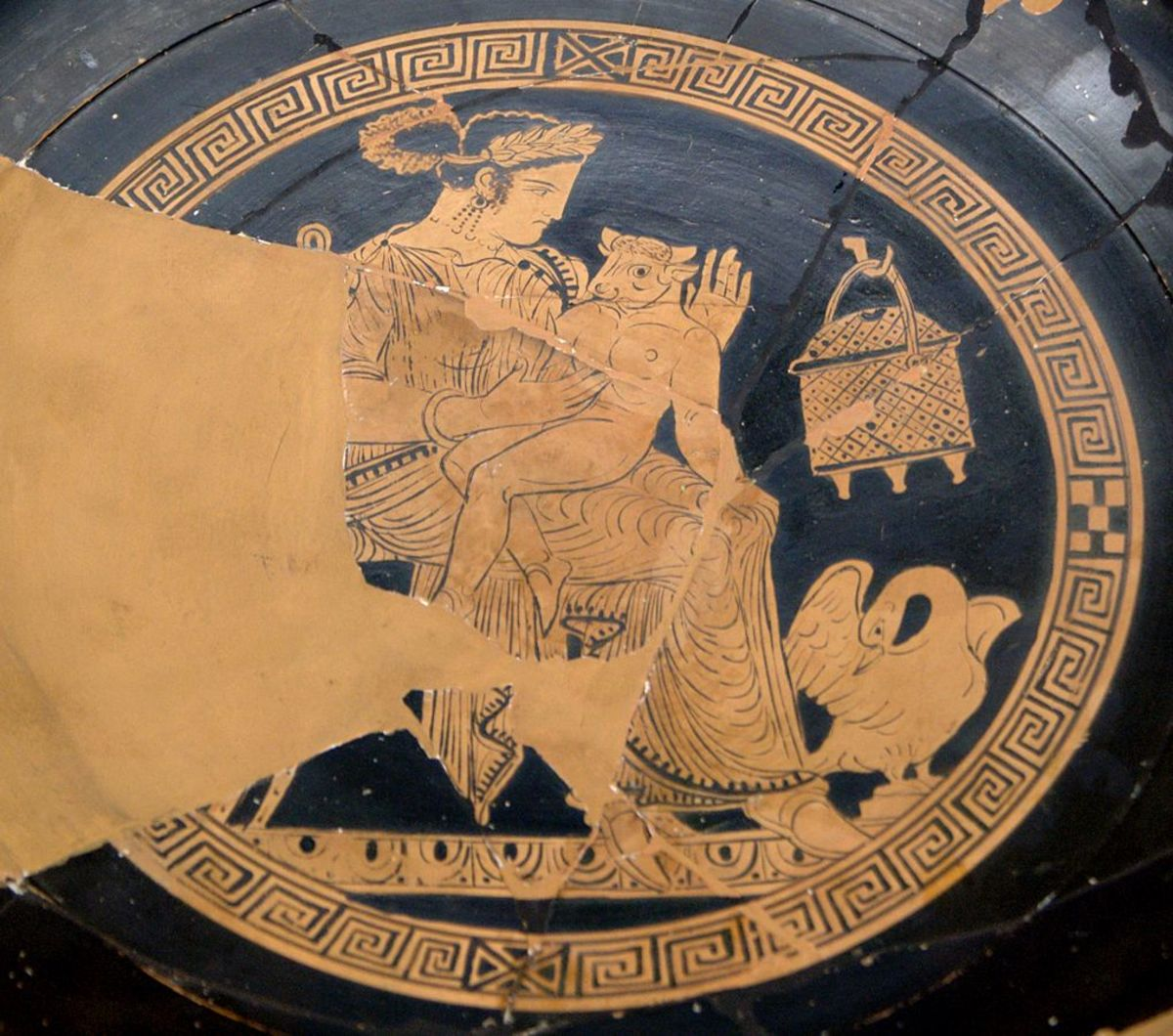 Cute baby Minotaur with mother Pasiphae. From a Greek Kylix (bowl).