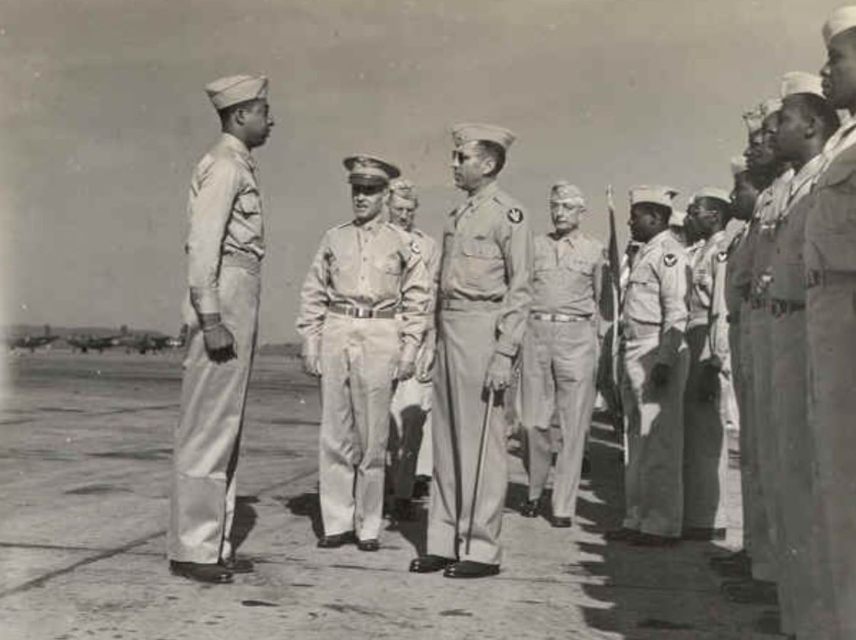 Col. Robert R. Selway reviewing the 618th Bomber Squadron (part of the 477th).