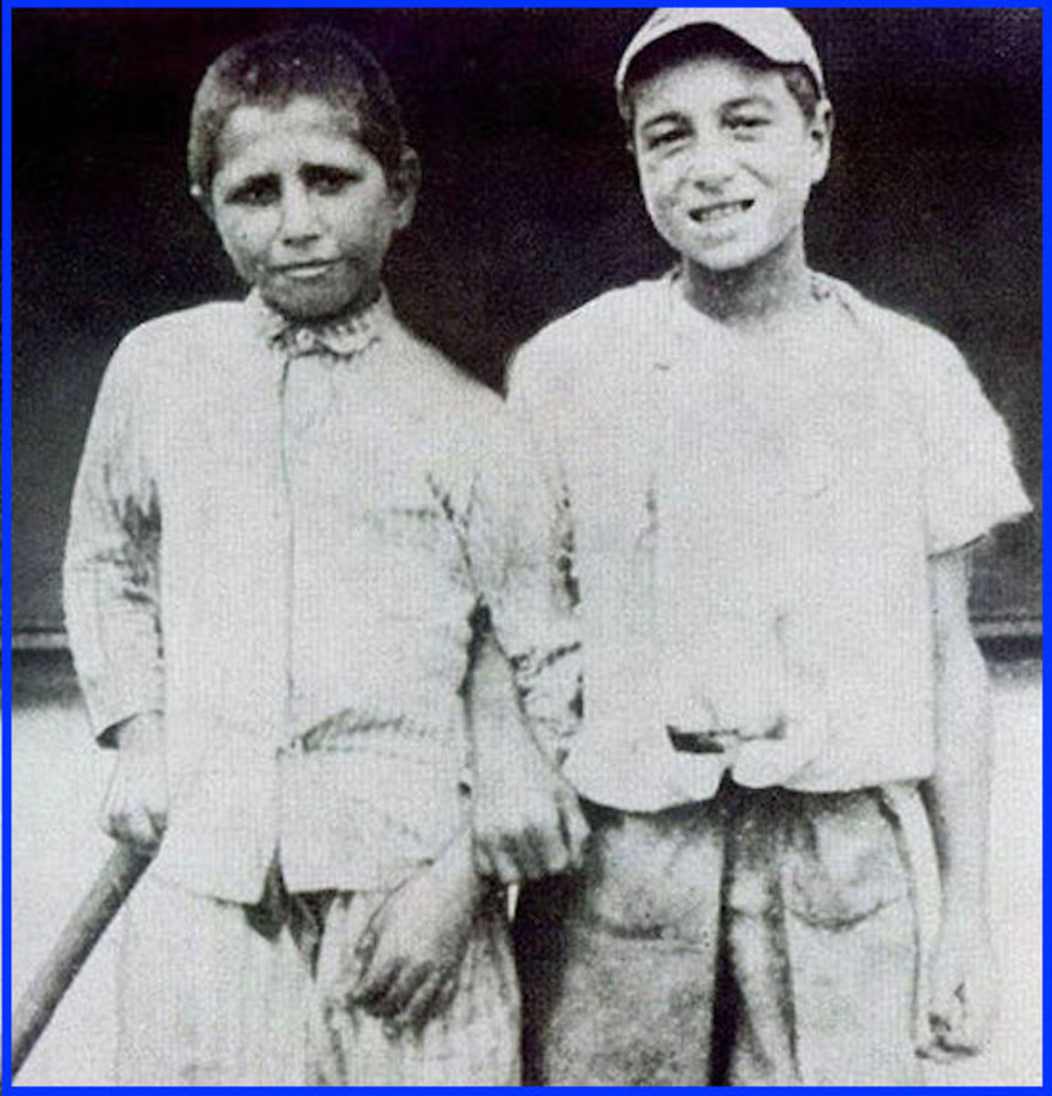 Here's Babe Ruth (on the right) at age seven, shortly after entering St. Mary's Industrial School for Boys.