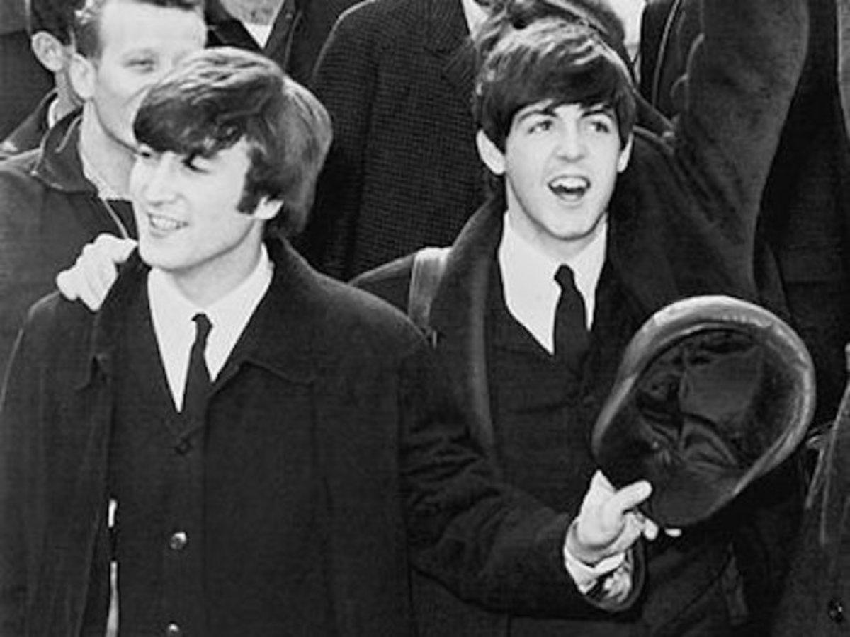Celebrity orphan John Lennon and his best mate Paul McCartney.