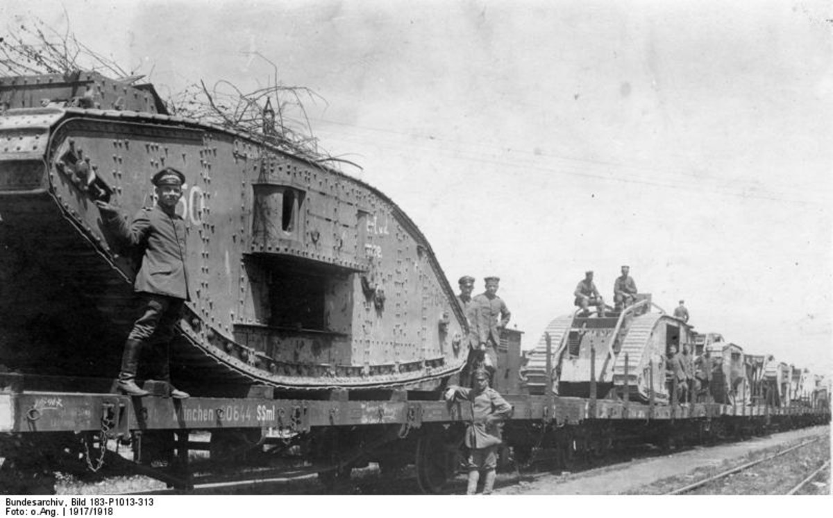 WW1: Captured British tanks ready for transport by rail to be refurbished and returned to the front. Circa 1917.