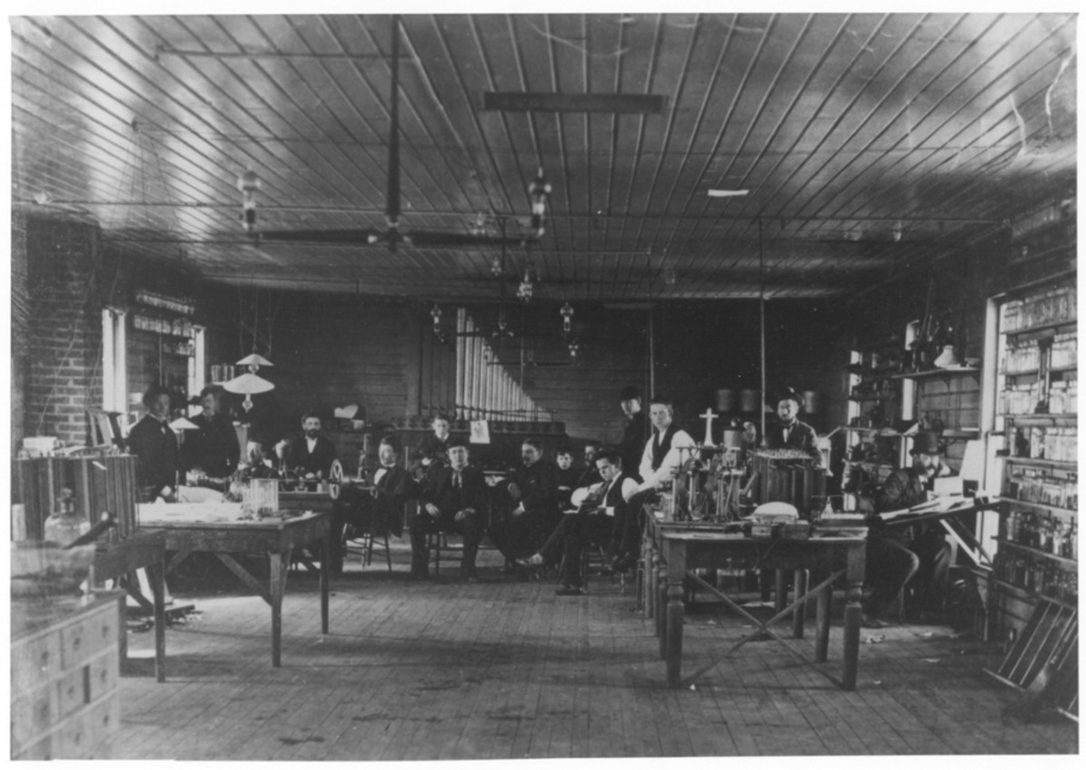 1880 photograph shows of the Menlo Park lab. Surrounding Edison are laboratory assistants, who carried out the many details of Edison's experiments.