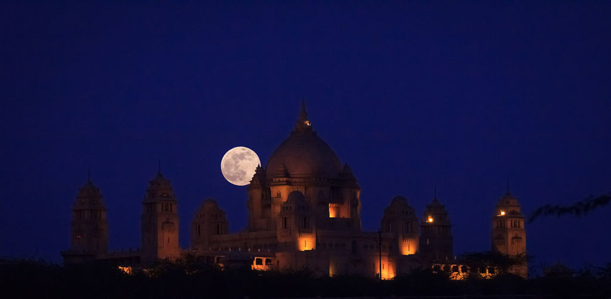A super moon rising behind a temple in the nation of India