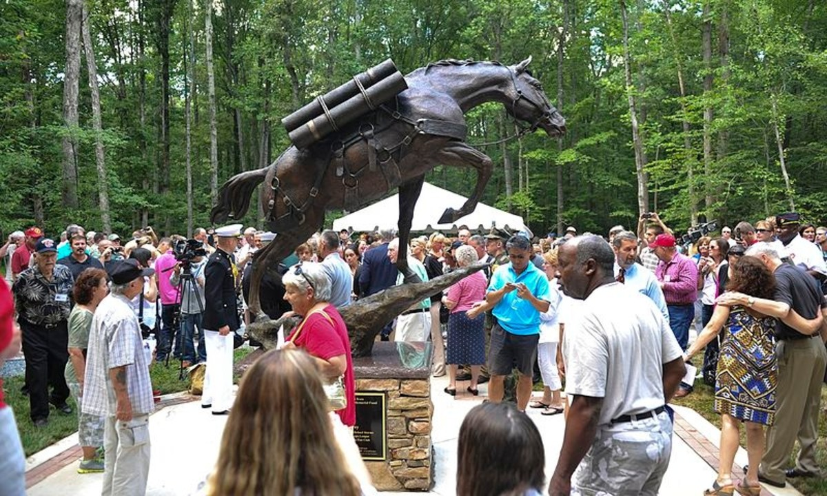 Visitors view the full-size bronze statue of Korean War Horse Staff Sgt. Reckless at the National Museum of the Marine Corps, Triangle, Va., July 26, 2013. The Commandant of the Marine Corps, Gen. James F. Amos, was in attendance.