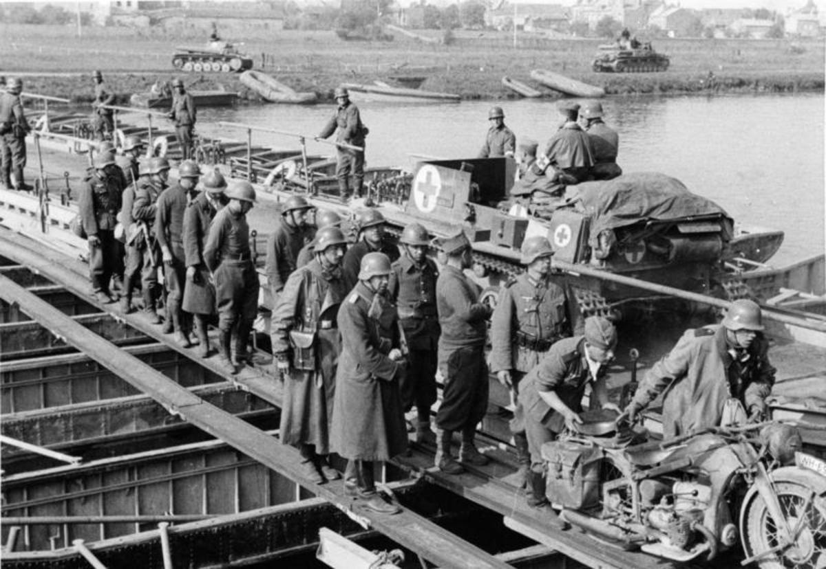 German tanks crossing the River Meuse somewhere near Sedan note French prisoners  walking along the edge of the bridge.