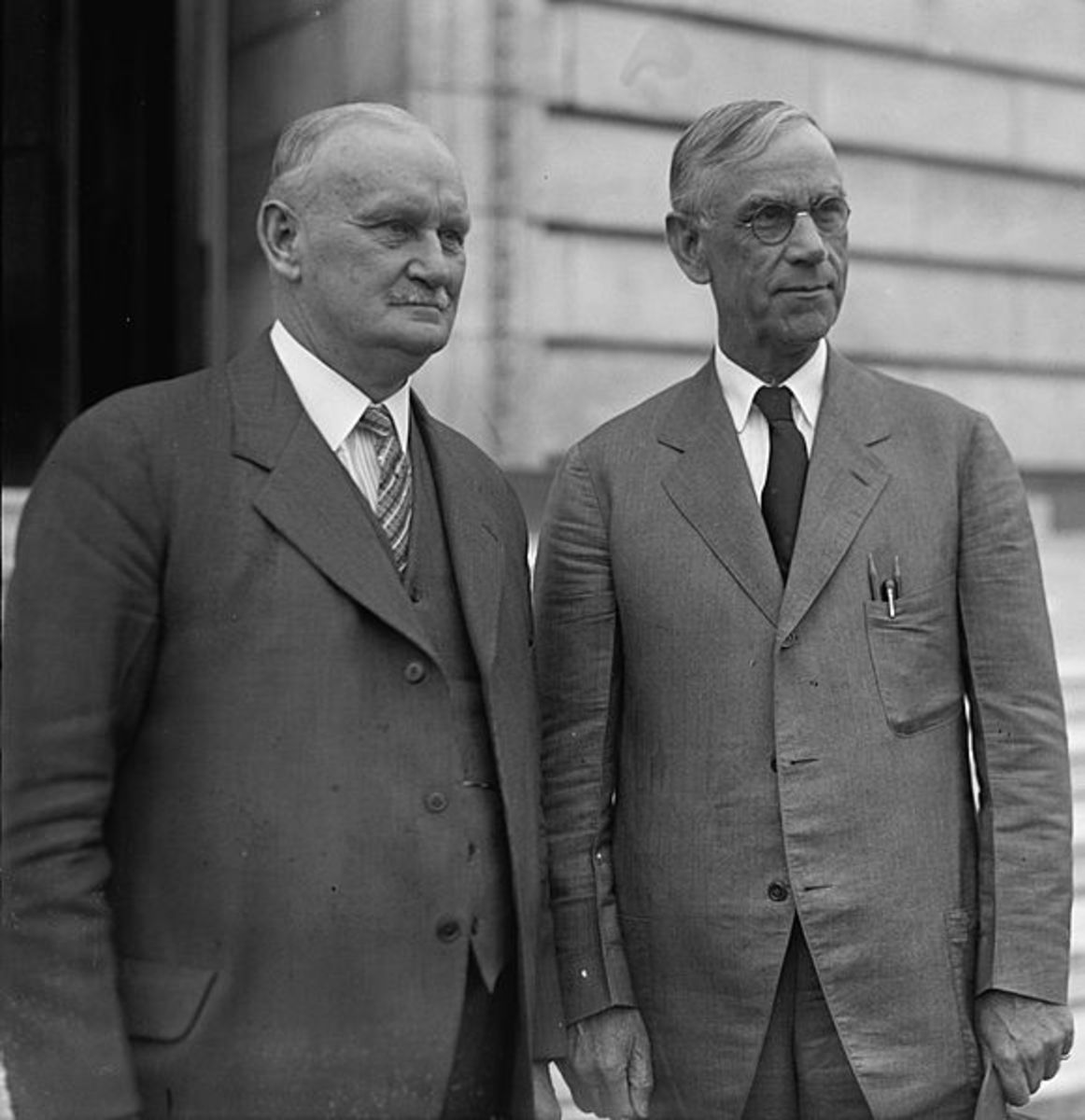 Willis Hawley (left) and Reed Smoot.