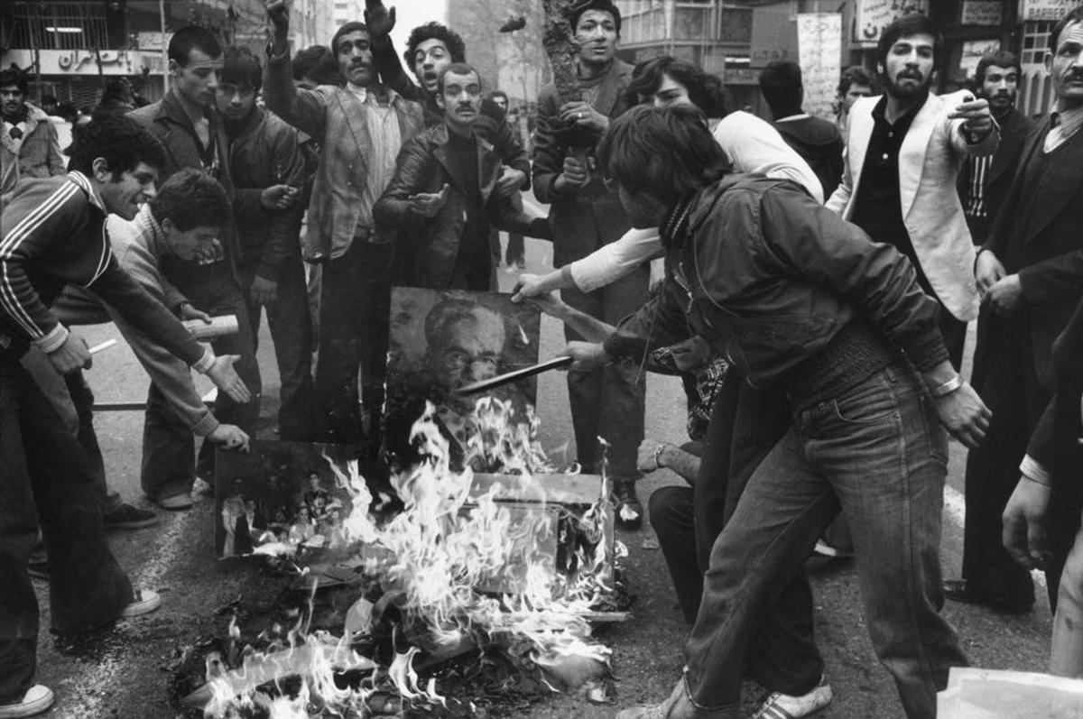 Protesters burned photos of the Shah.