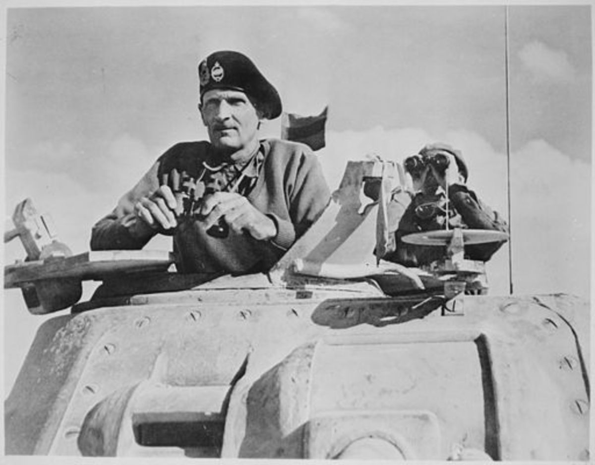 Monty at El Alamein, wearing the famous beret with two badges