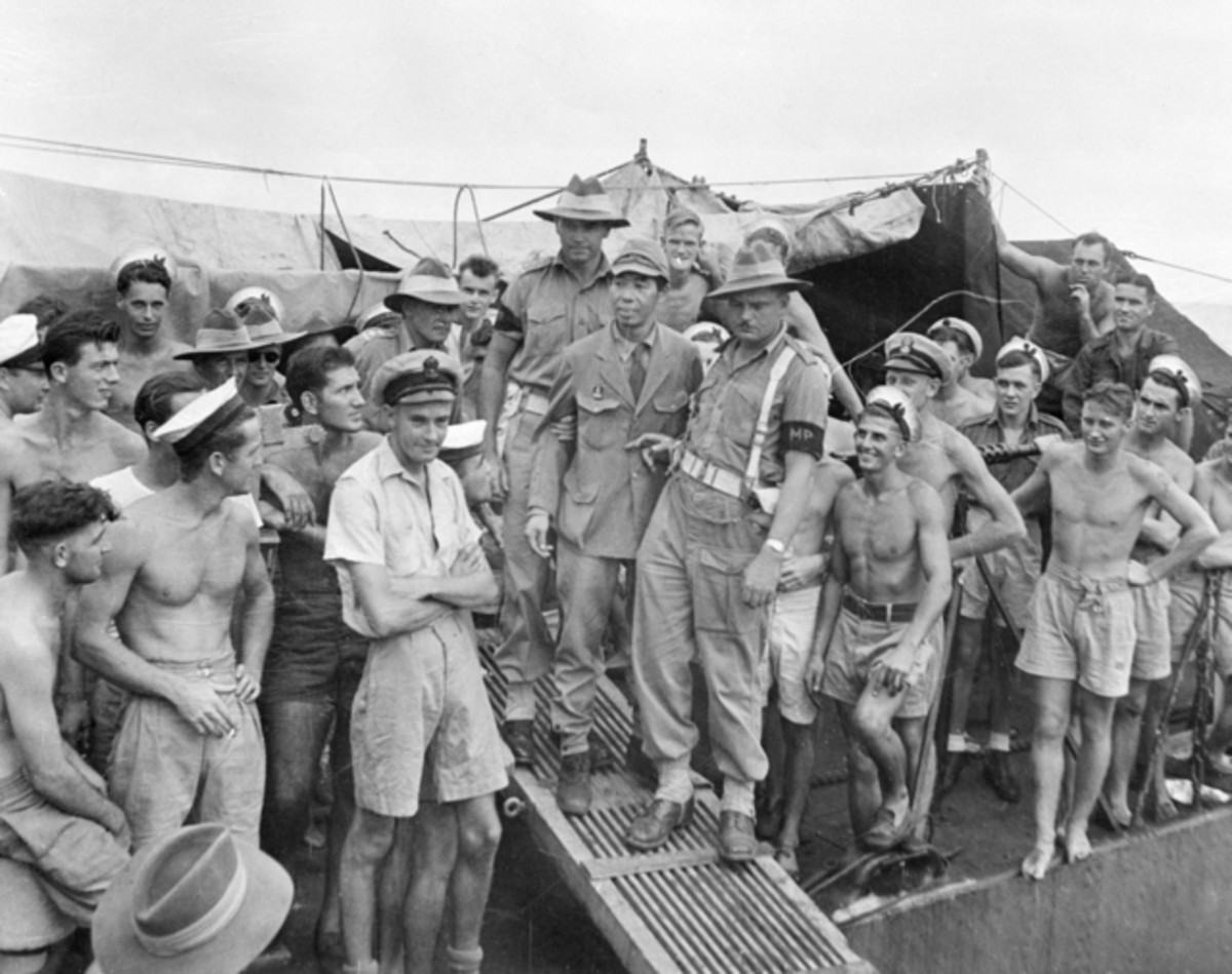 The sadistic manager of a PoW camp in Indonesia, Ikeuchi Masakiyo, is escorted by Australian military police. Masakiyo was executed for war crimes in 1947.