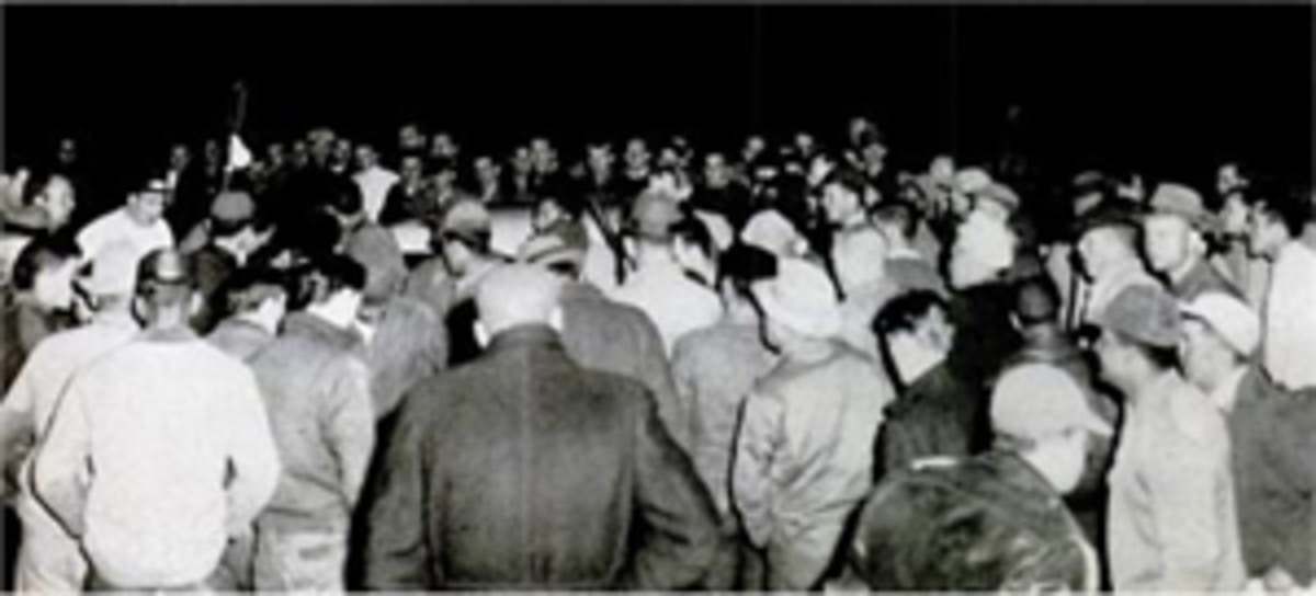 Lumbee men swarm the car of a Klan supporter