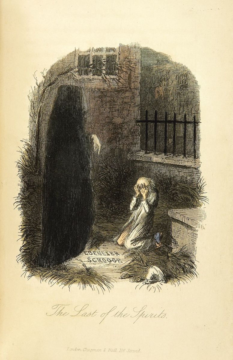 The terrifying spirit of Christmas future, shows Ebenezer Scrooge his own grave.