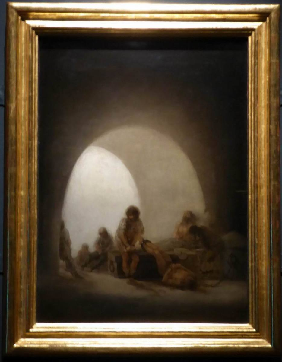 Goya shows us seven ghostly figures incarcerated in a dark, damp prison. Image by Frances Spiegel with permission from The Wallace Collection.
