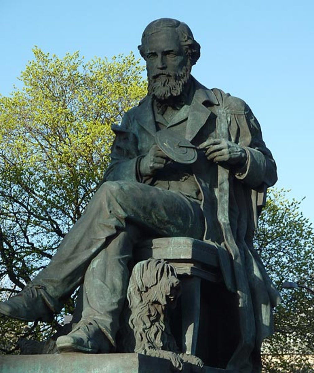 "Statue of James Clerk Maxwell on George Street in Edinburgh, Scotland. Maxwell is holding his color wheel and his dog ""Toby"" is at his feet."