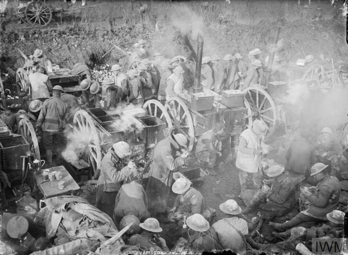 British soldiers get a hot meal at a field kitchen in 1916.