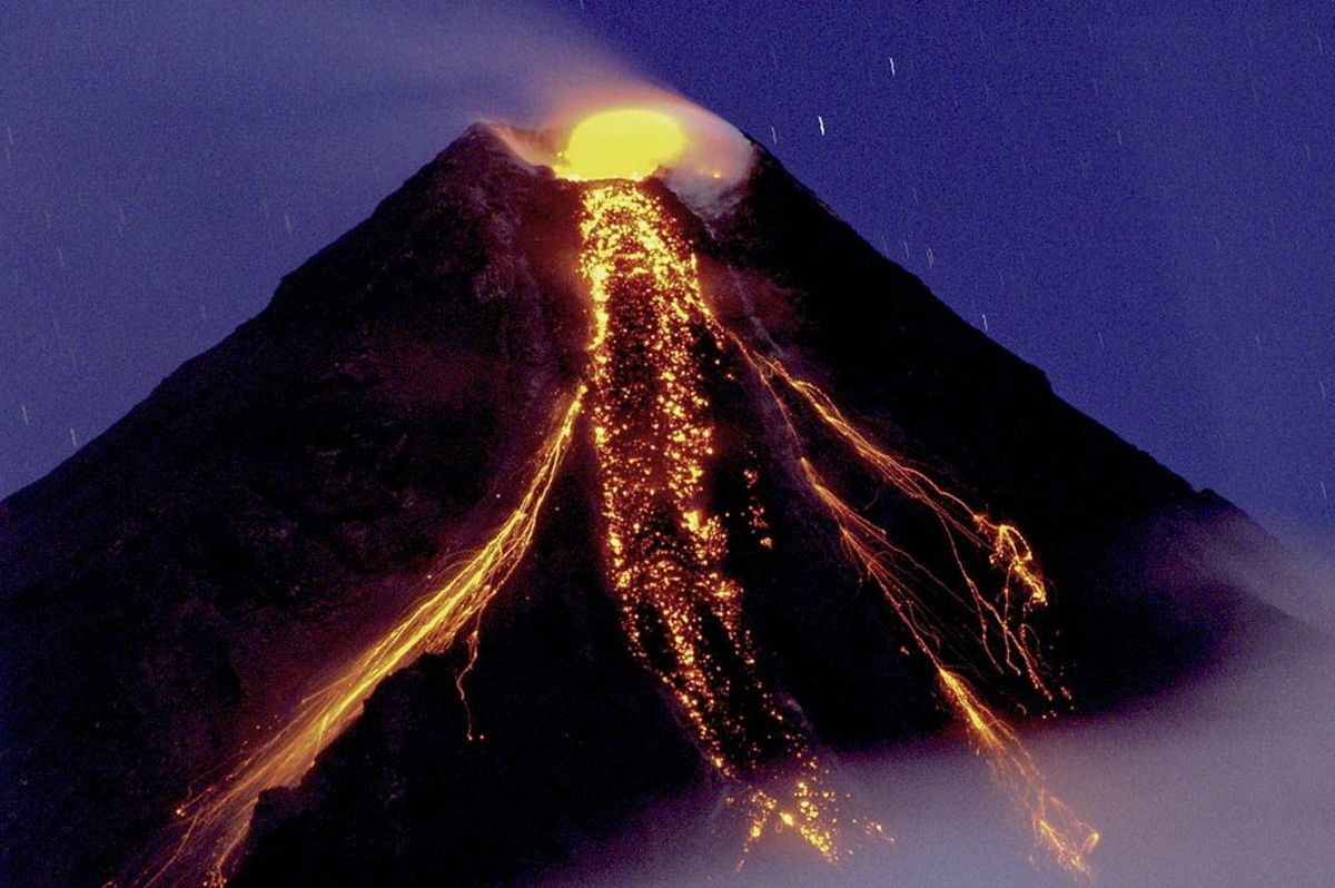 A December 2009 eruption on Mayon creates a colorful scene.