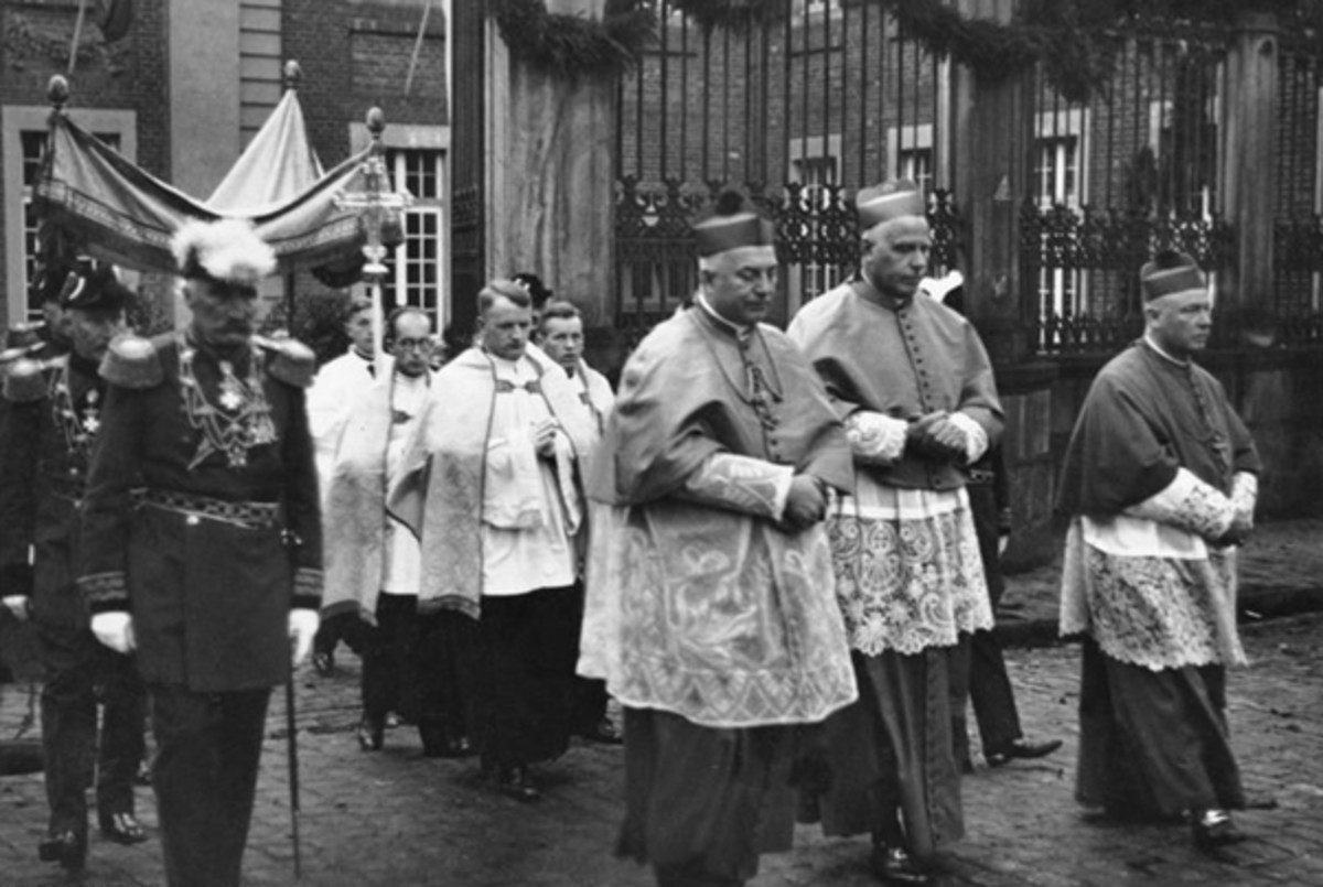 The bishop leads a Corpus Christi procession.