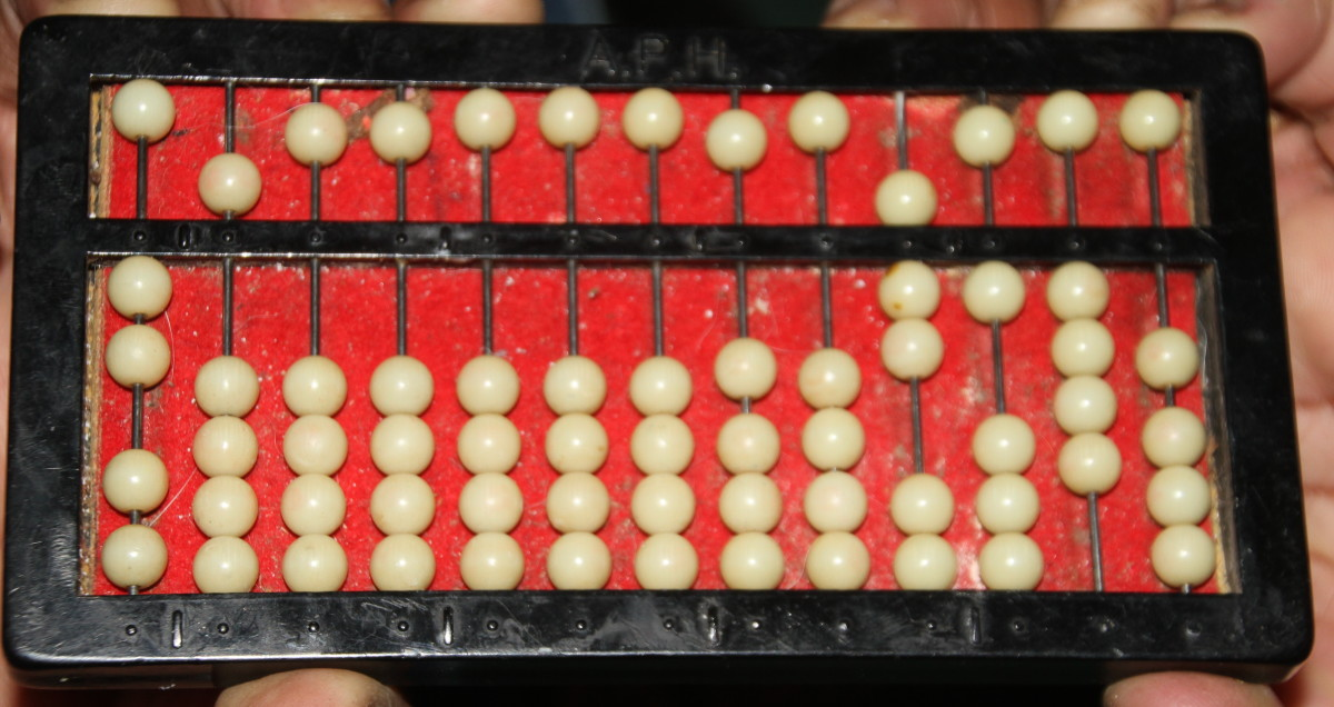 "Here the abacus shows ""7 times two tens""."