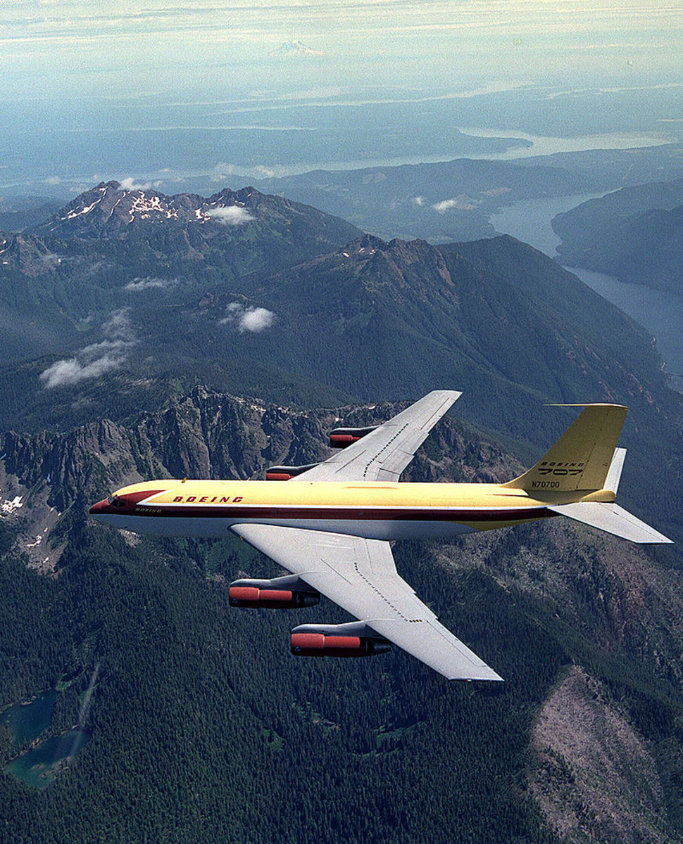 "The Boeing 707 prototype, a model 367-80 ""Dash 80"" flying over the Olympic Peninsula."