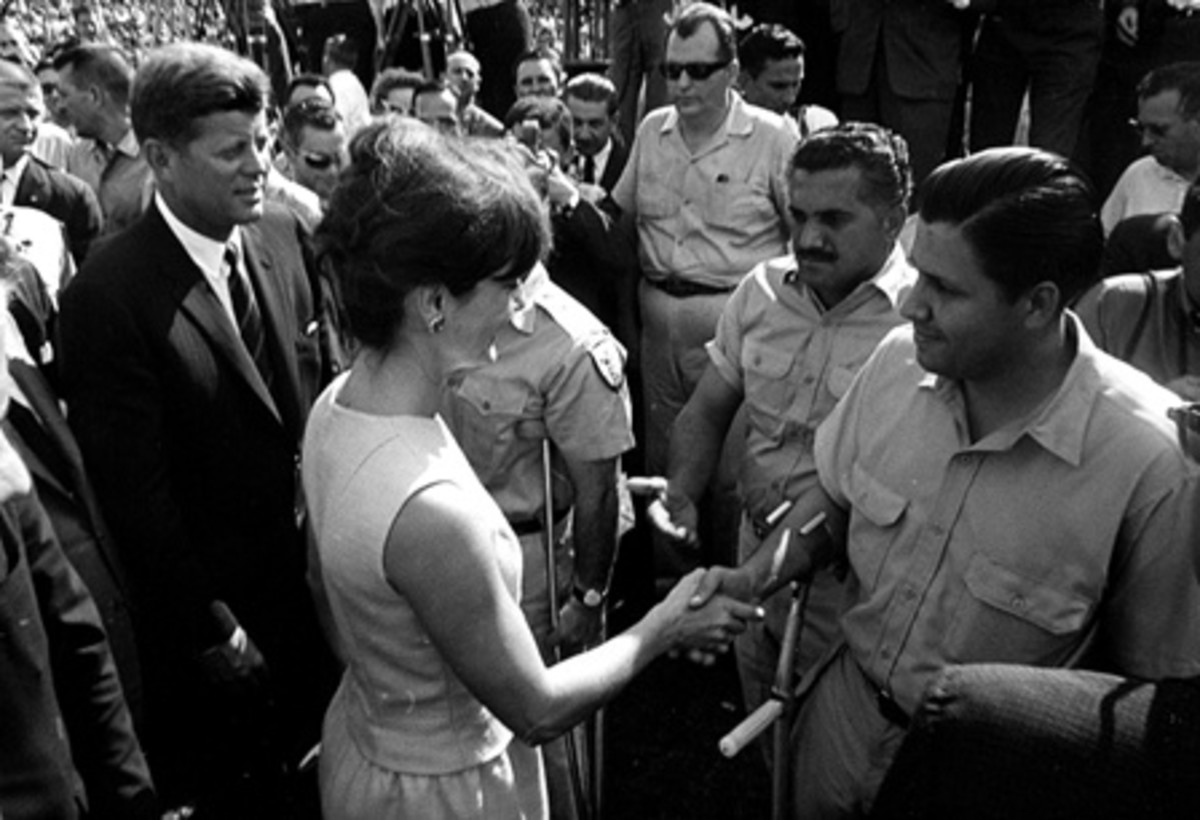 President John F. Kennedy and Jacqueline Kennedy greet members of the 2506 Cuban Invasion Brigade. Miami, Florida, Orange Bowl Stadium on December 29, 1962.