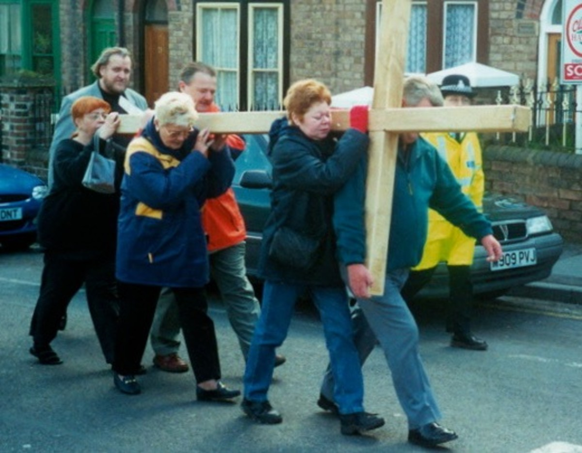 Carrying the Cross through the town on Good Friday (England).