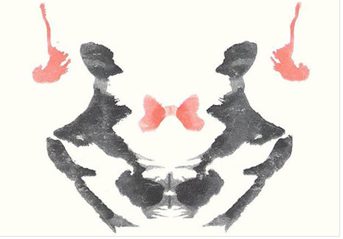 Rorschach Test - I see an alien with big black eyes, its arms held aloft and antlers protruding from its head... yes, seriously.