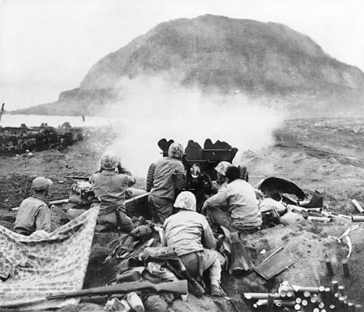 Marines returning fire towards Mount Suribachi.