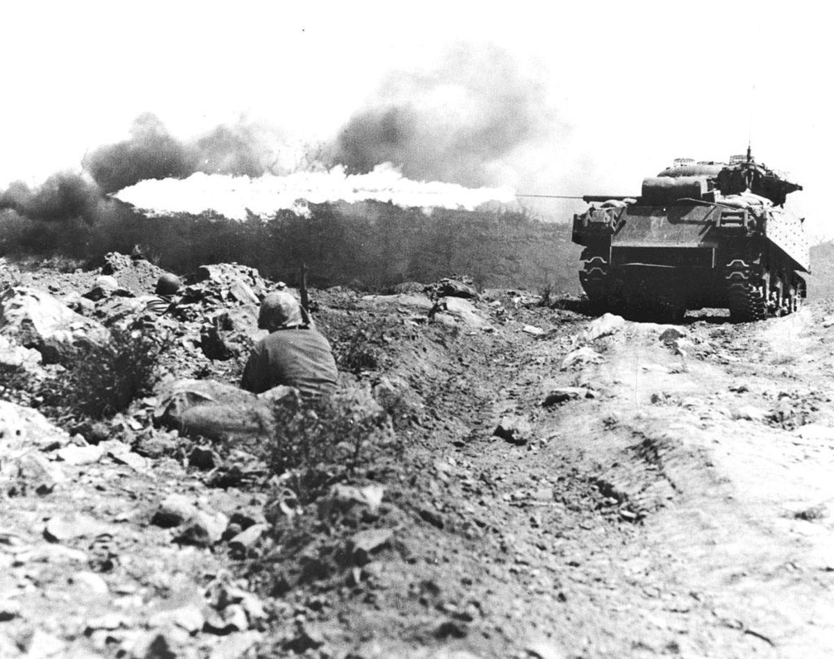 Marines use flamethrowers to destroy enemy bunkers.