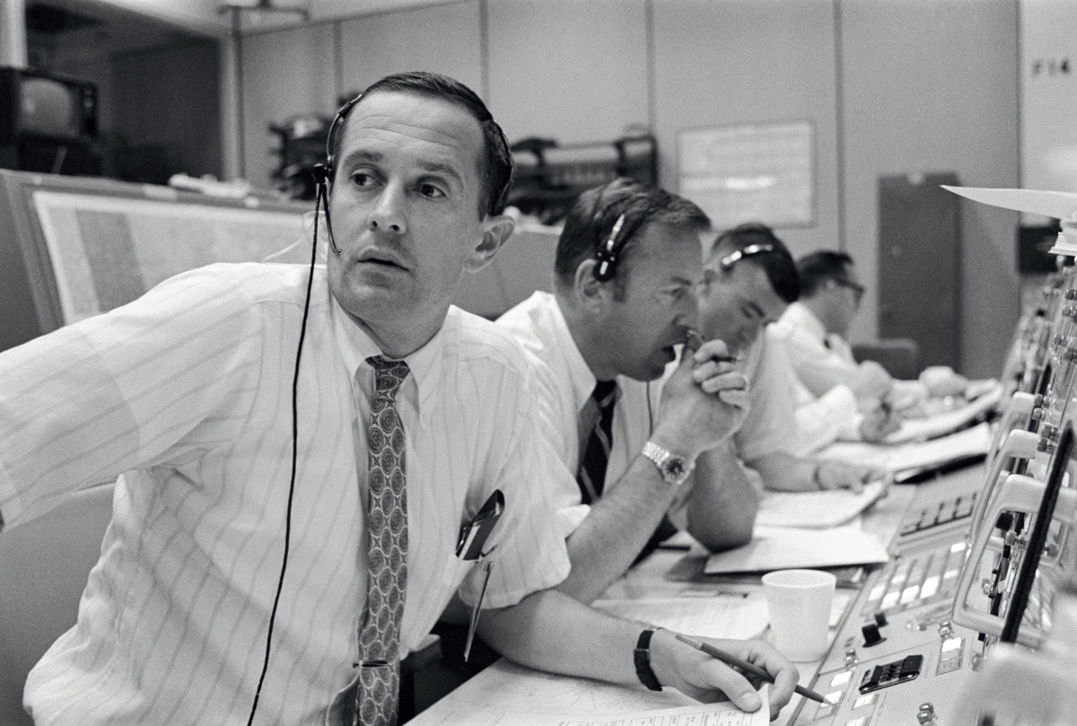 Charlie Duke, James Lovell, and Fred Haise at Mission Control during Apollo 11.