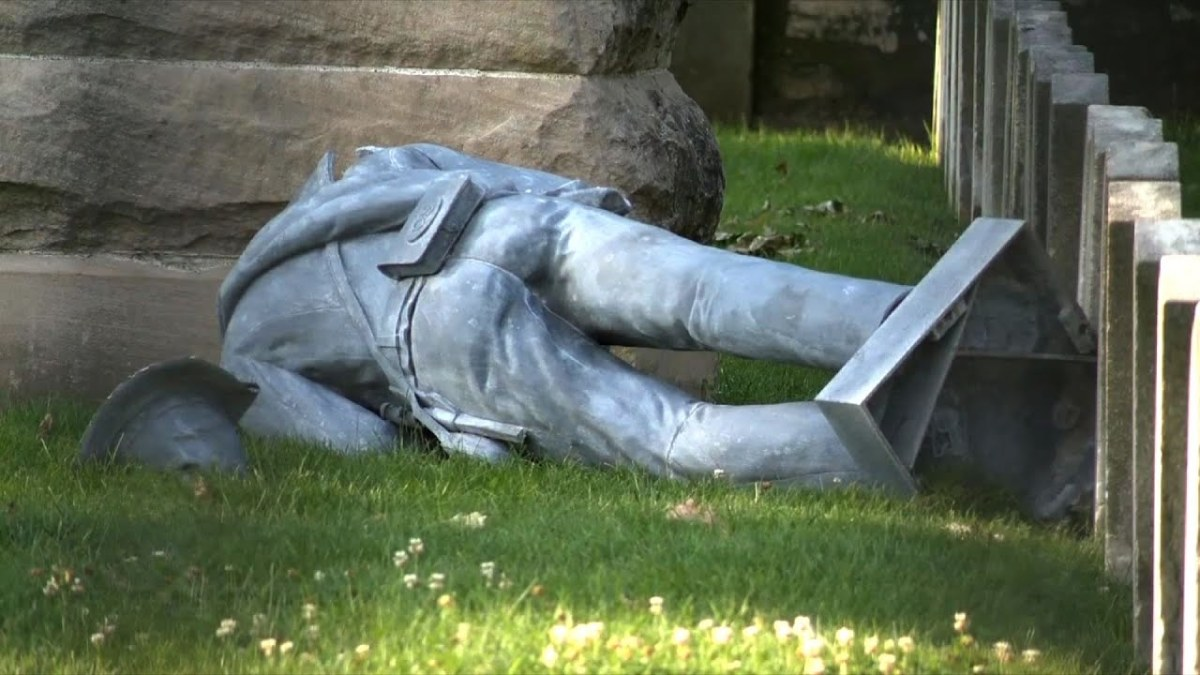 The toppled statue.