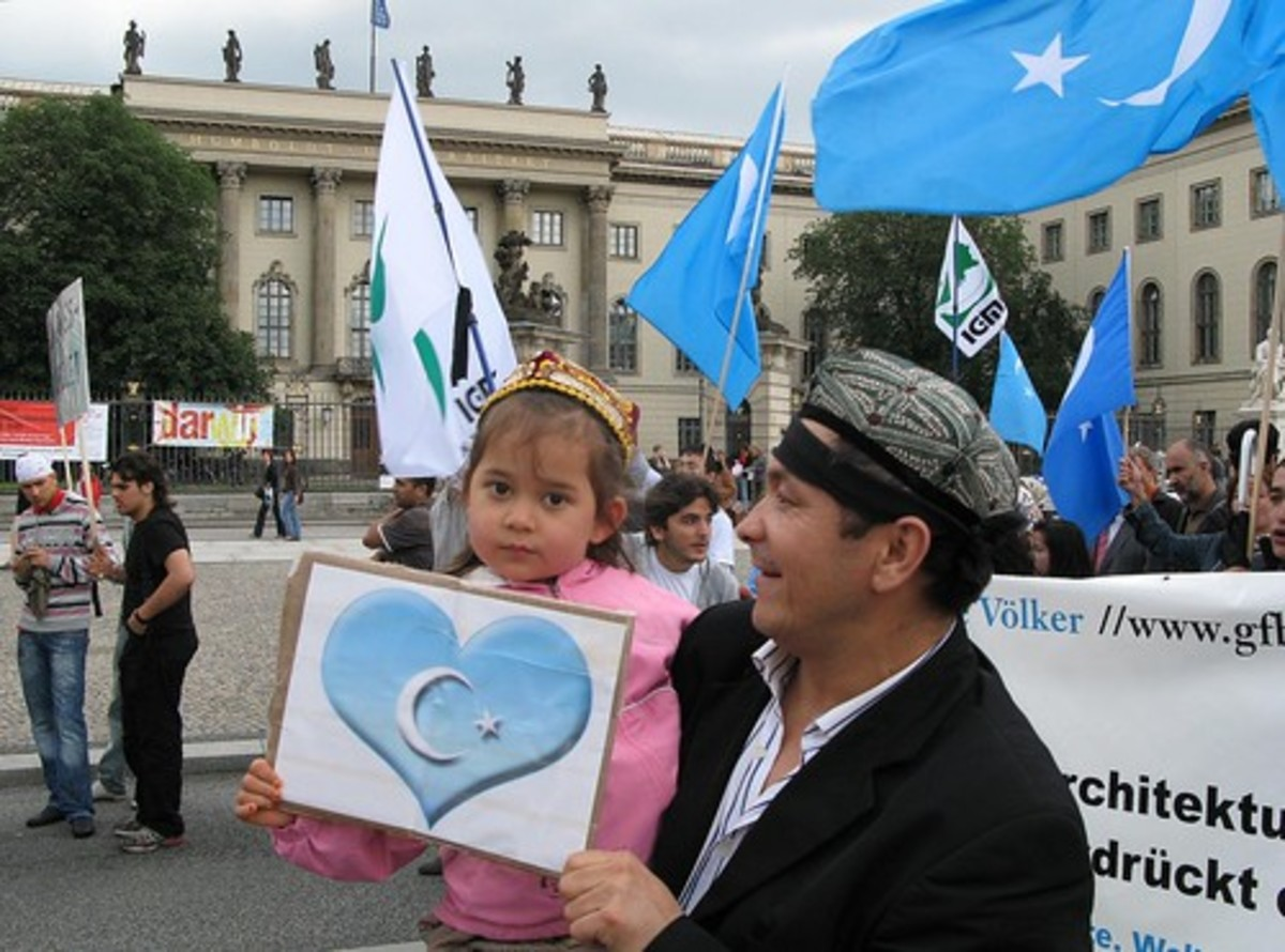 A mild Uighur protest in Berlin that would land this man behind bars for a long time in China.