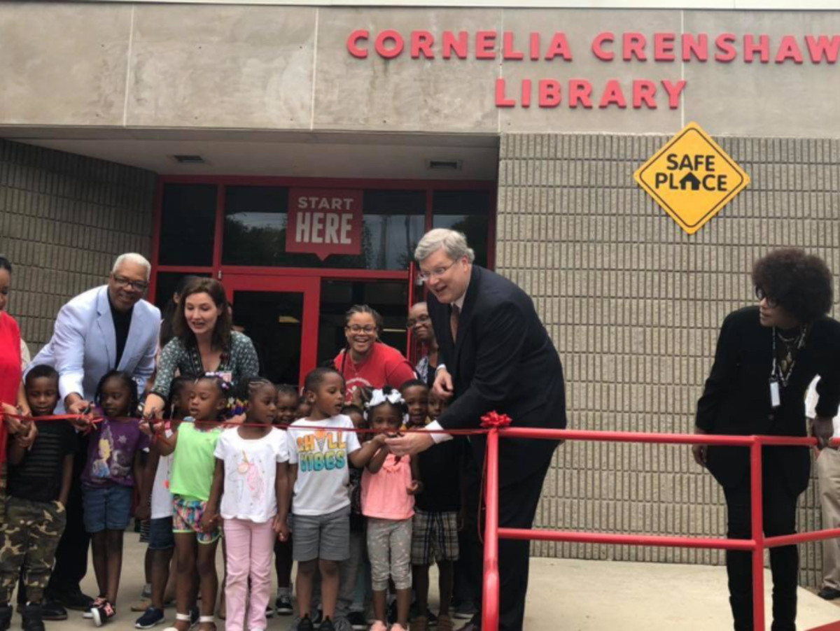 Mayor Jim Strickland (white shirt, dark suit) cuts the ribbon at the opening of the reimagined Cornelia Crenshaw Library branch in September 2019 in Memphis.