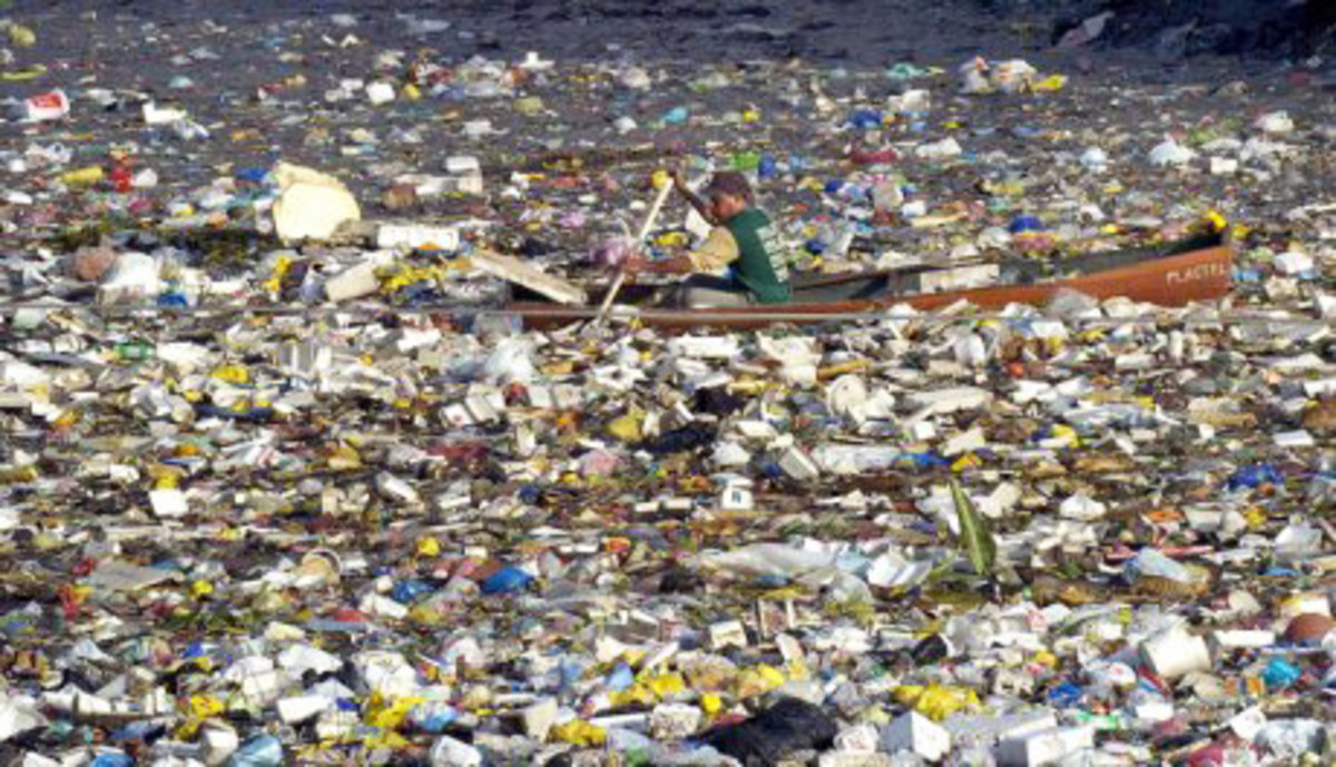Sometime attributed to the Great Pacific Garbage Patch, sometimes to a harbor in the Far East, this ocean is so cluttered you can barely see the rowboat in the middle of it.