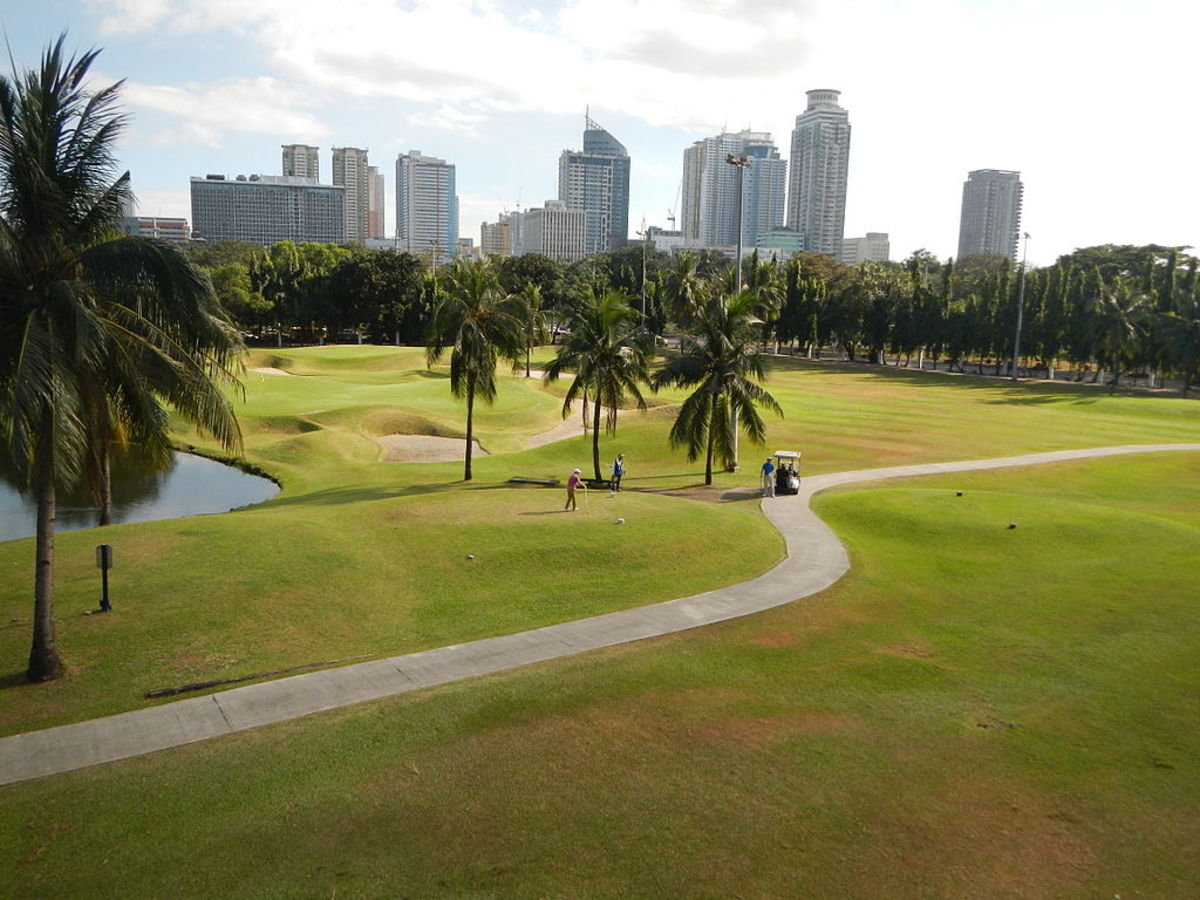 Intramuros golfclub with city skyline in background. About 2 million live in Manila today.