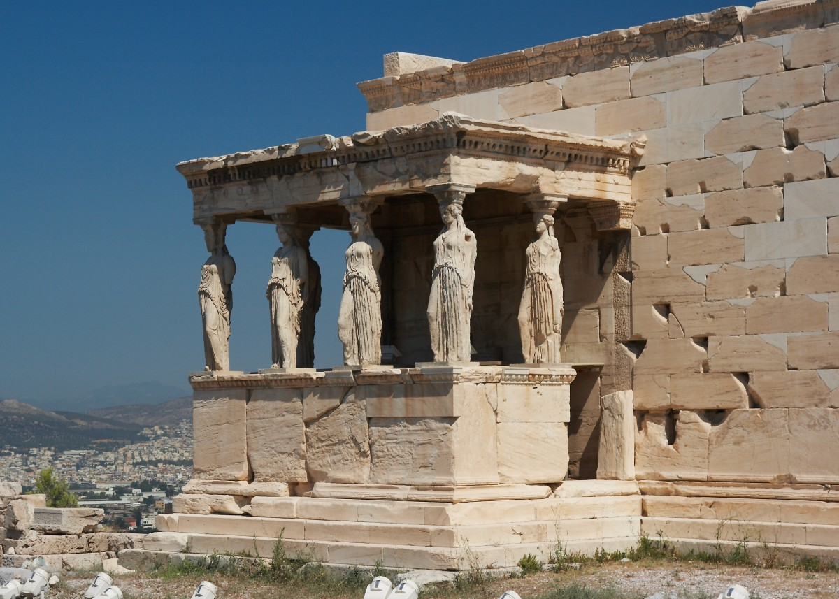 The Erechtheum with Caryatids (huge female statues) at the Acropolis of Athens