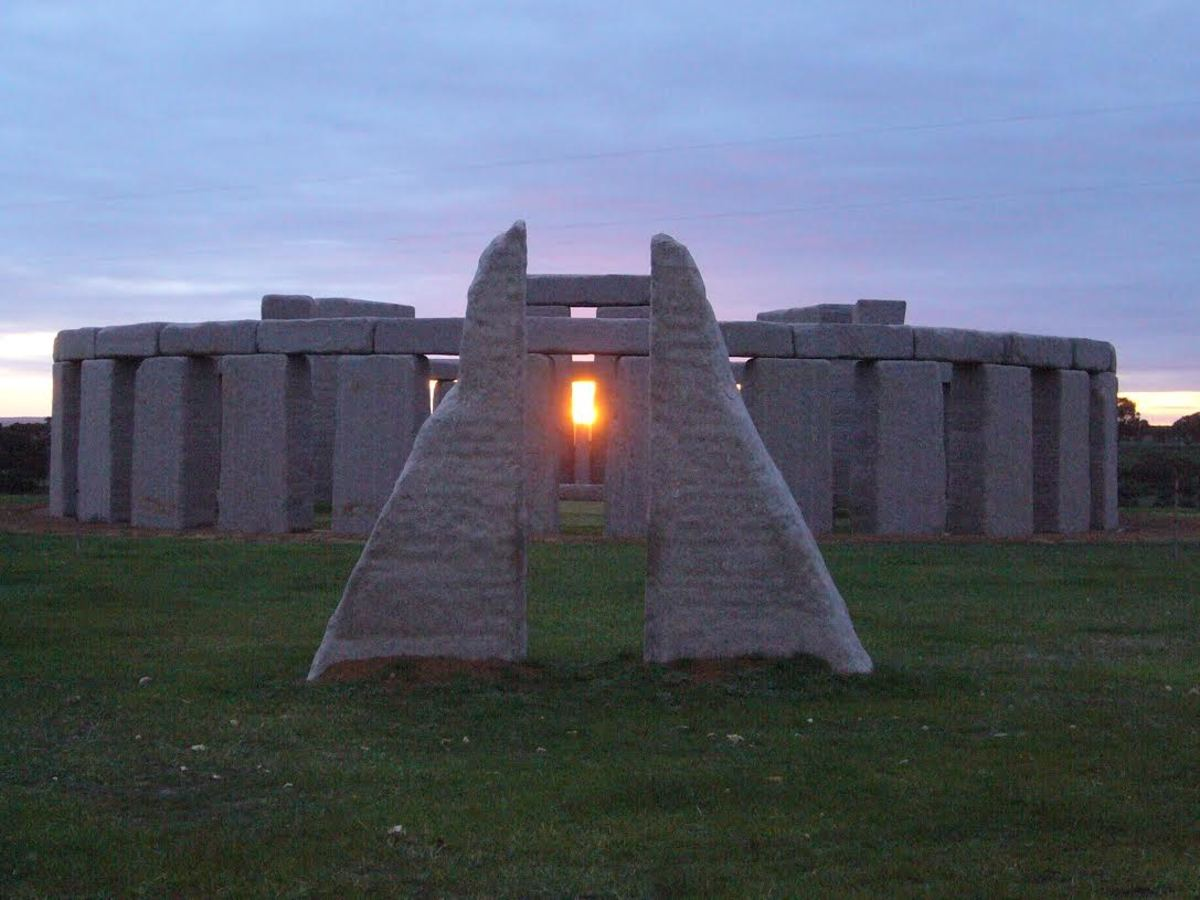 Artist's depiction of ancient Stonehenge at the summer solstice sunrise
