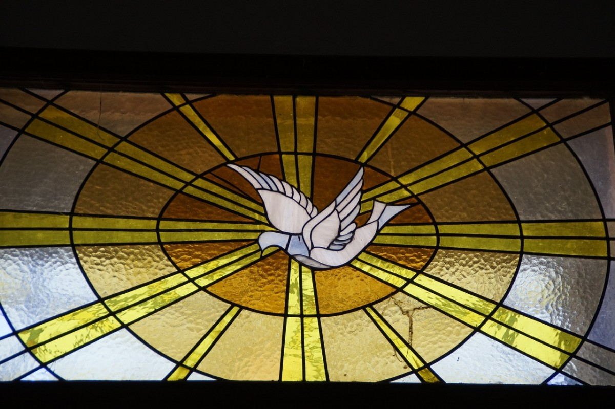 A dove depicted in stained glass.
