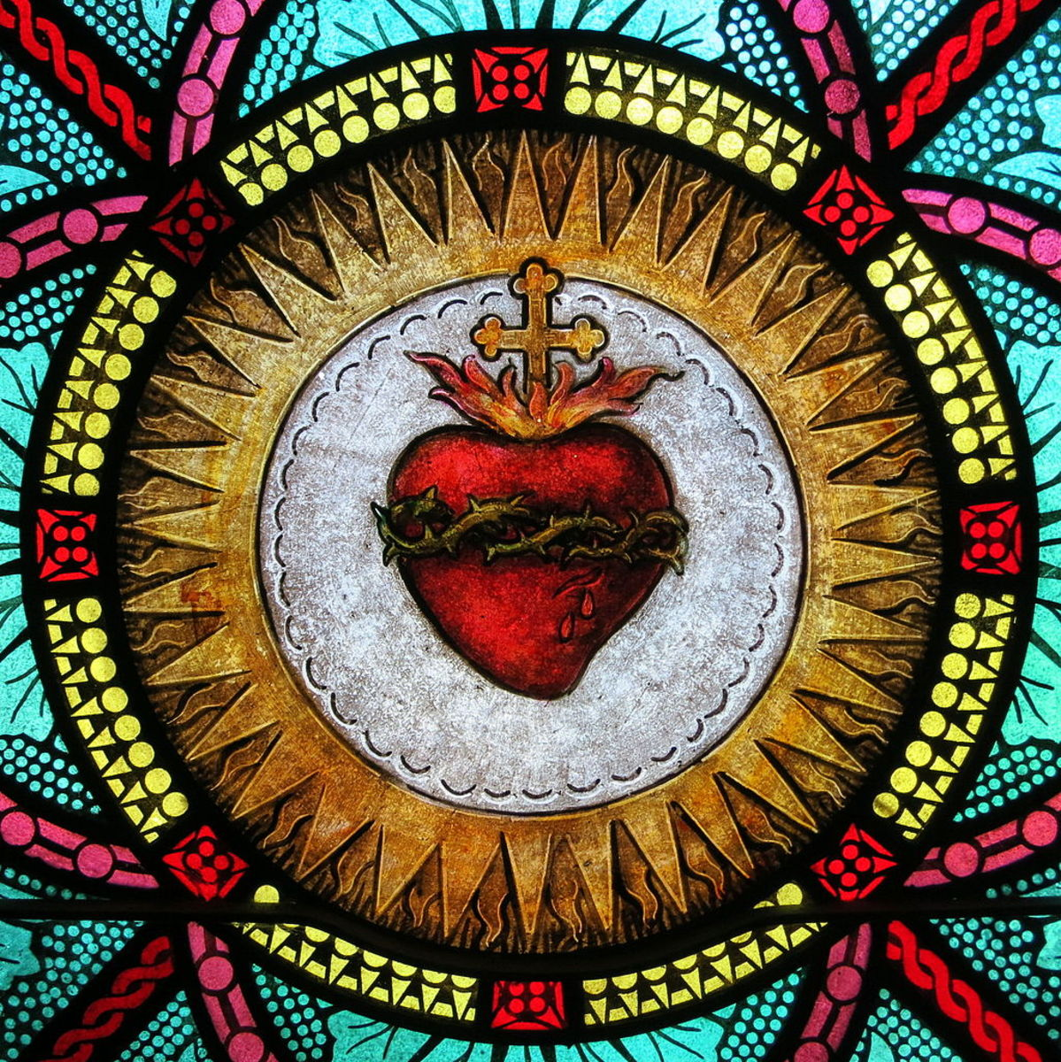 Stained glass of the Sacred Heart at All Saints Catholic Church.