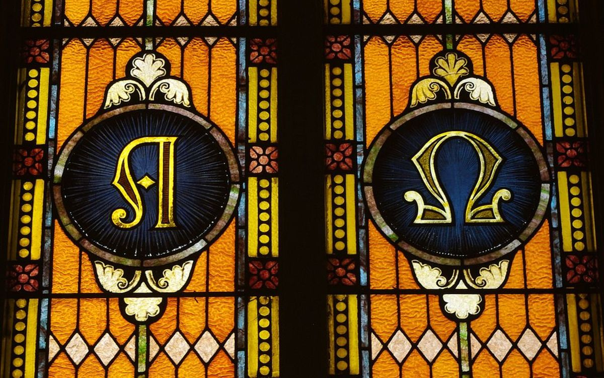 Alpha and omega depicted in stained glass at Saint Mary Catholic Church.