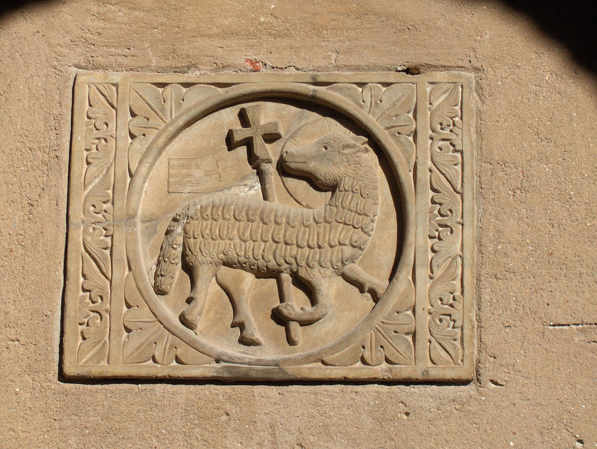 """Lamb of God (Agnus Dei)"" with halo and cross on the wall of the atrium of the St. Euphrasius basilica, Poreč, Croatia."