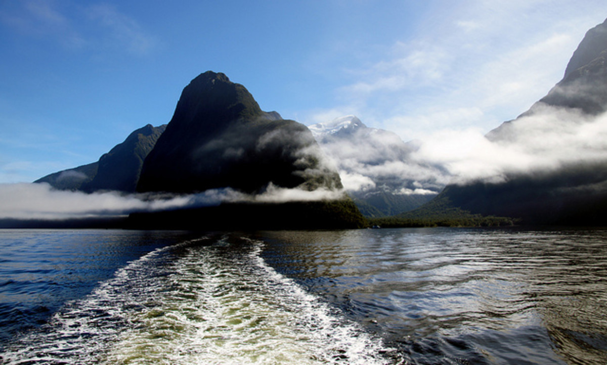 Milford Sound NZ and a long white cloud.