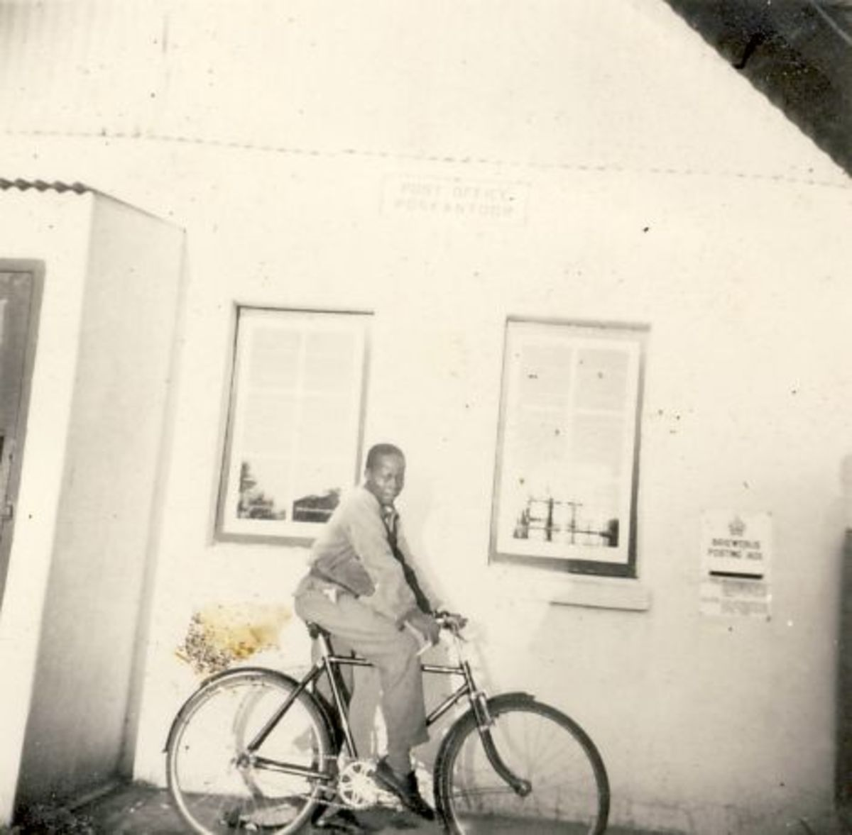 My great friend Boy Bikitsha on his bicycle in front of the Blythswood Post Office