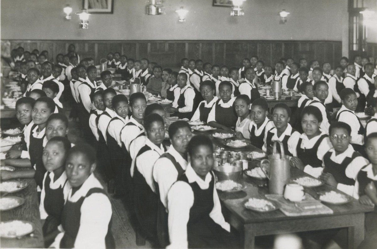 Students at a meal in the Girls' Boarding Department