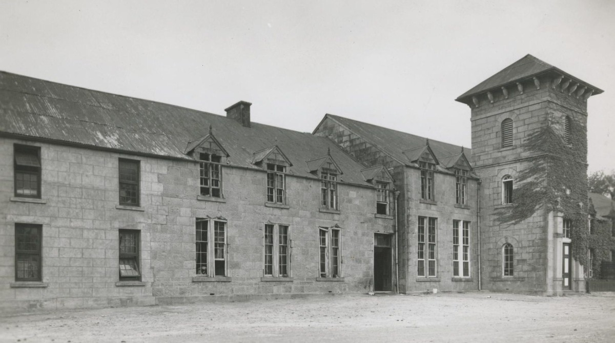 The main building in about 1948 showing the Boys' Boarding Department. The bell tower added in 1899 in memory of Matthew Blyth is to the right of the photo. The tower also held the bell donated by Nogaga.