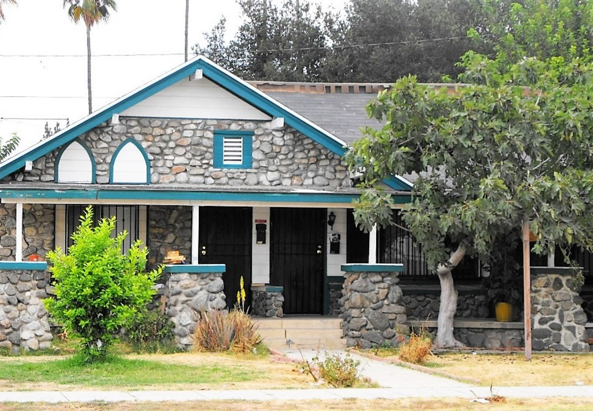 A bungalow duplex with field stone construction. You can imagine by the work of the cement that needed repairs were done, or different masons worked on the pillars. This house is located in Pomona, CA.