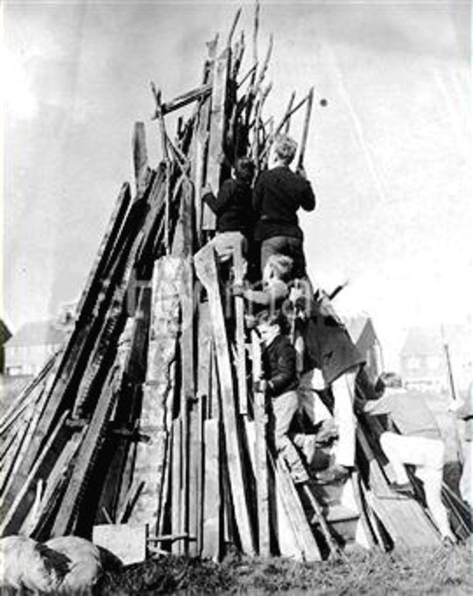Boys building a bonfire