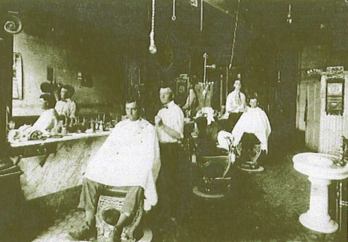 Grover Cleveland Franklin working in a barber shop on the square.